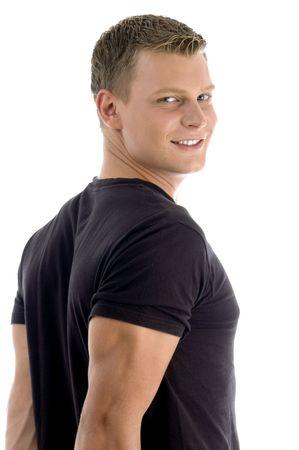 side pose: lado plantean muscular de un hombre aislado sobre fondo