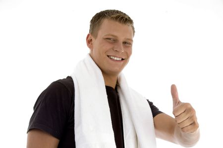 smiling man showing thumb gesture on an isolated background photo