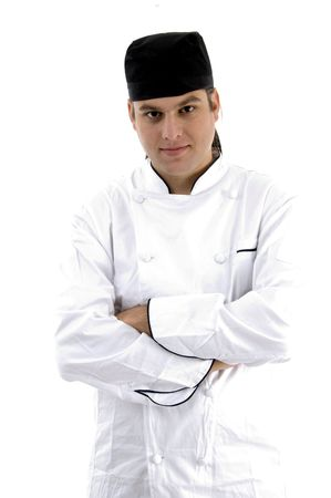 portrait of chef posing in uniform against white background photo