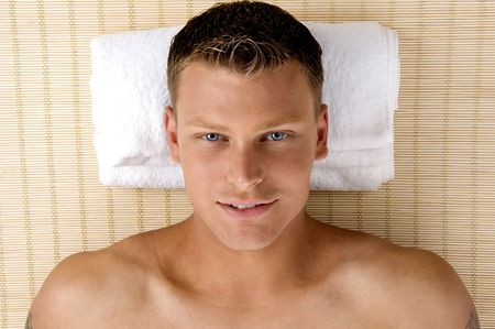 man relaxing in a spa salon on an isolated white background
