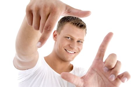 handsome model framing his face on an isolated white background
