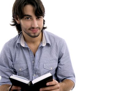 young male with his diary on an isolated white background