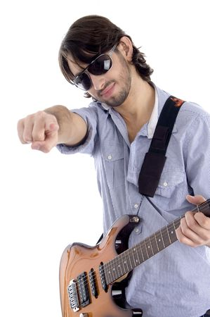 young guitarist with pointing finger against white background Stock Photo - 3817142