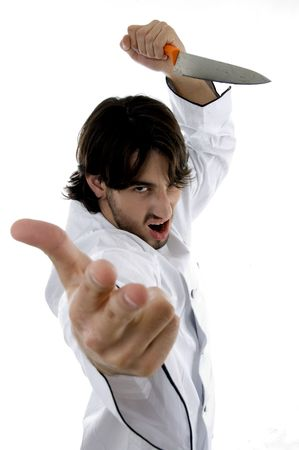 young violent chef against white background photo