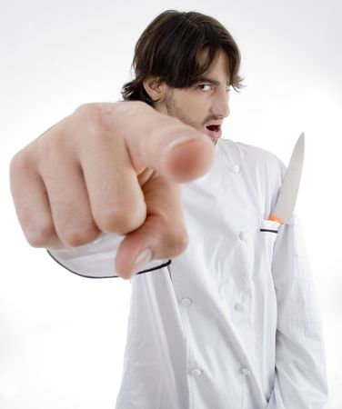 male chef with knife in pocket isolated on white background photo
