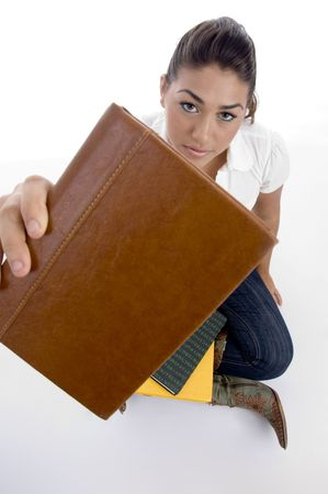close up view of teenager students book on an isolated white background photo