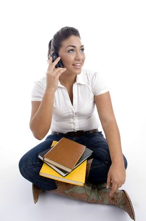 young student busy on phone call against white background photo