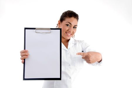 smiling doctor indicating the writing board against white background photo