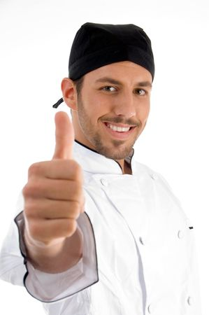 chef showing approval sign on an isolated background Standard-Bild