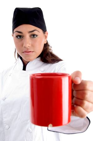 chef showing you coffee mug against white background photo