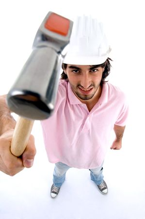standing architect showing hammer on an isolated background photo