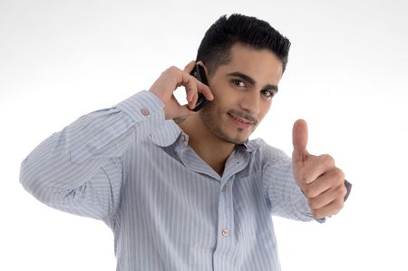 goodluck: man talking on cell phone and wishing goodluck on an isolated white background