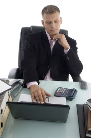 businessman working on laptop on an isolated white background photo