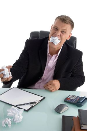 frustrated businessman with paper in his mouth on an isolated background photo
