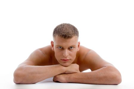 laying muscular male looking at you on an isolated white background photo