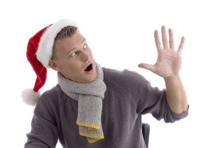 smiling young man with christmas hat showing five fingers on an isolated white background photo