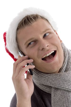 smiling male with christmas hat talking on cell phone with white background photo