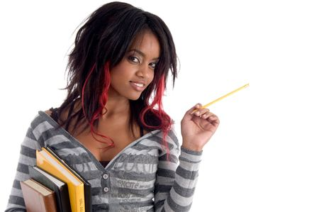 school girl posing with pencil and books on an isolated white background