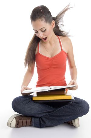 surprised student looking into book on an isolated background Stock Photo - 3849233