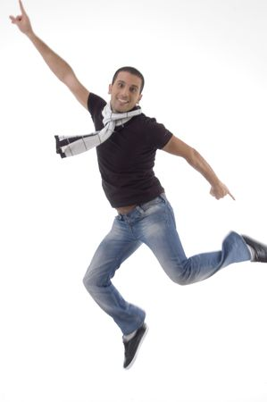 young male leaps in air on an isolated background