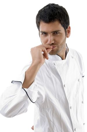 young chef posing with hands on mouth against white background Stock Photo - 3860994
