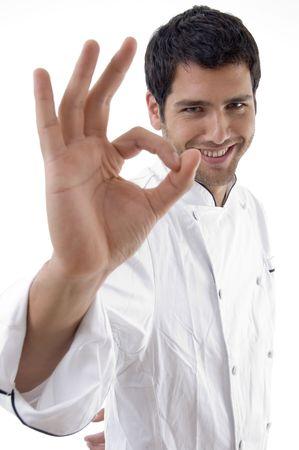 Mann in Uniform mit Küchenchef ok Zeichen auf einem isolierten Hintergrund Standard-Bild - 3860996