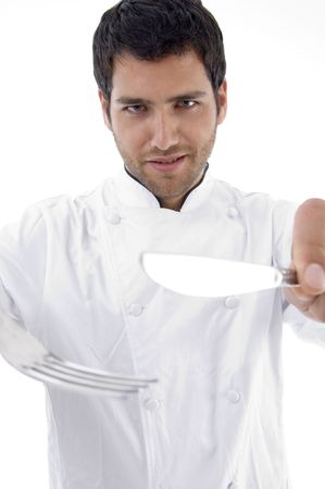 portrait of male chef holding cutlery on an isolated white background photo