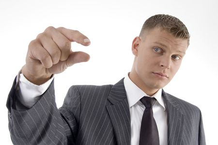 businessman showing measuring gesture on an isolated background photo