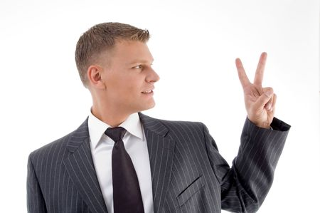 peace sign: portrait of businessman showing peace sign on an isolated white background