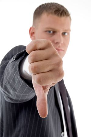 side view of businessman with thumbs down on an isolated background photo
