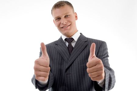 happy executive with thumbs up on an isolated white background photo