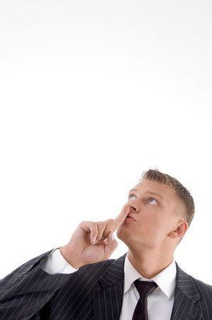 guardar silencio: Retrato de hombre de negocios pidiendo a guardar silencio con fondo blanco Foto de archivo