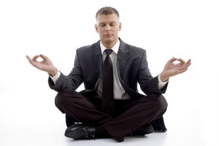 Handsome Young Executive praktizieren Yoga mit weißem Hintergrund Standard-Bild - 3867045