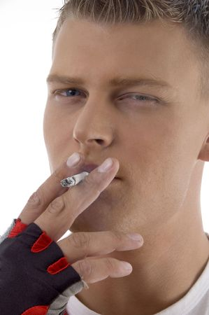 sportive guy smoking on an isolated background photo