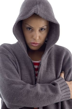 female with hood coat looking at camera against white background photo