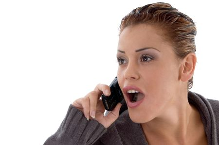 surprised woman on phone call on an isolated background photo