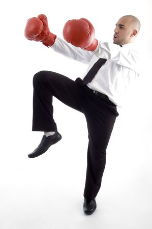 executive in action wearing boxing gloves  against white background photo