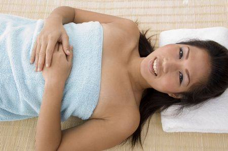 high angle view of smiling young woman going to take massage Stock Photo - 3881062