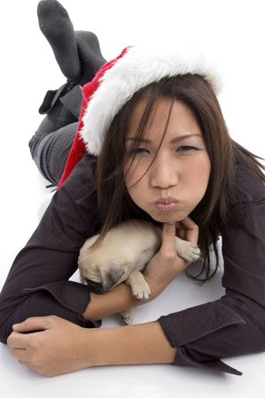 laying woman with christmas hat and pug on an isolated  white background Stock Photo - 3875069