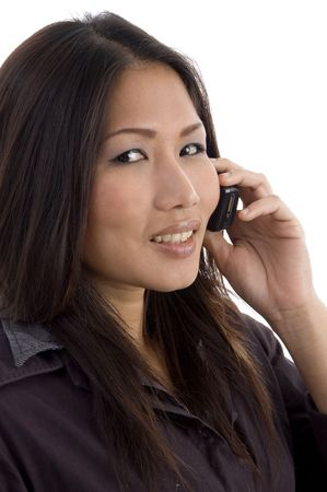 asian, chinese, japanese, korean, asian pacific, thai female talking on mobile on an isolated background photo