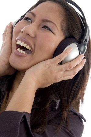 female enjoying headphone on an isolated background photo