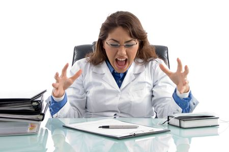 frustrated doctor in workplace on an isolated white background Stock Photo