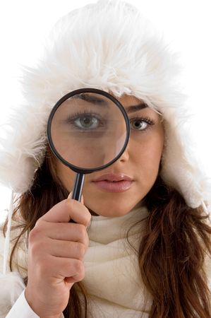female looking through magnifying glass against white background photo