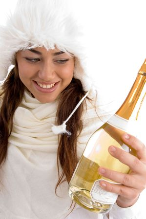 smiling female holding champaign bottle on an isolated white background photo