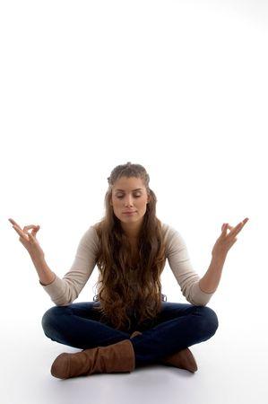 21: youth female doing meditation against white background Stock Photo