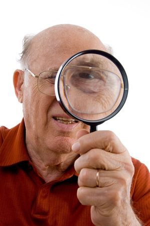 old man looking through lens against white background