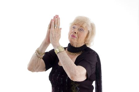 praying old woman against white background photo