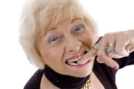 close up of old woman keeping finger in her mouth on an isolated background Stock Photo - 3892374