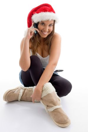 female wearing christmas hat and talking on mobile on an isolated white background photo