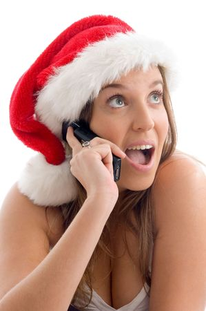 woman wearing christmas hat and talking on cell phone with white background photo